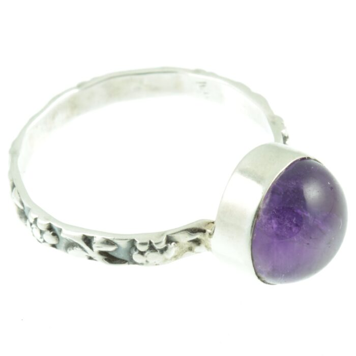 Decorative amethyst and silver ring - side view