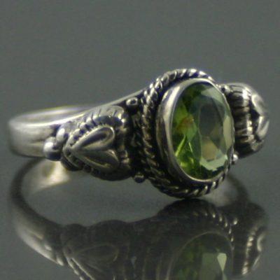 Oval cut peridot silver ring