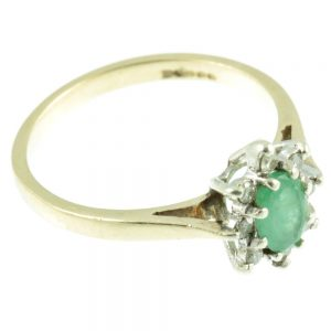 Emerald and diamond ring - side view