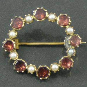 Georgian garnet and split pearl brooch