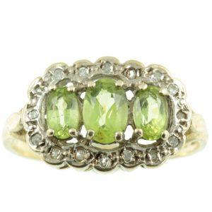 Gorgeous 3 stone peridot and diamond ring