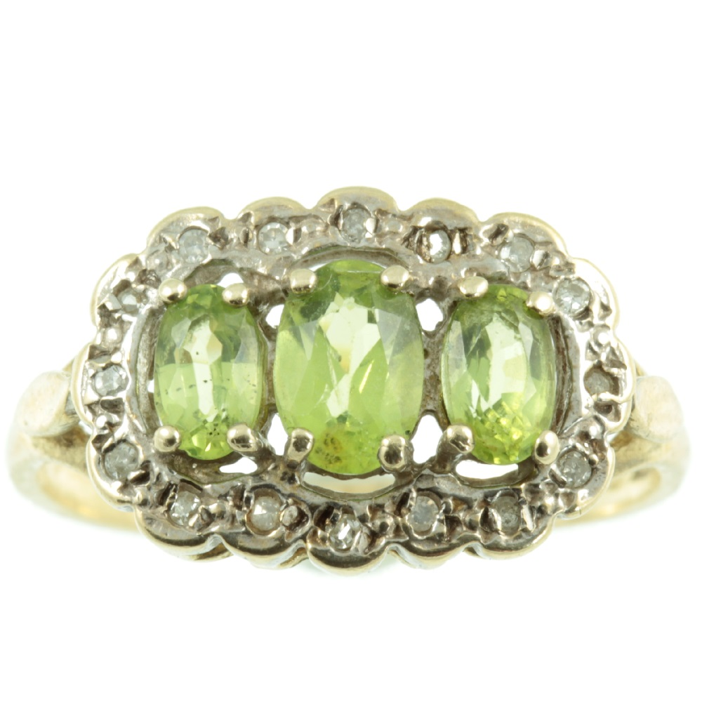 Gorgeous 3 stone peridot and diamond ring