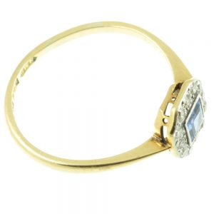 Shoulder view of art deco sapphire and diamond ring
